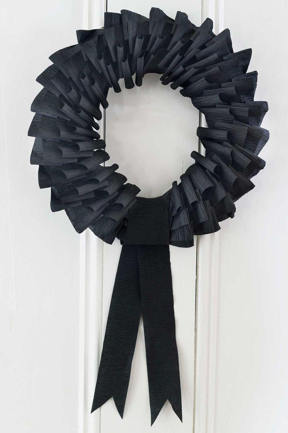 "<p>This eery wreath is as simple as folding black streamers around a foam wreath form. Once you make the basic wreath, you can decorate it with plastic spiders, bats, or whatever creepy crawlies you'd like. </p><p><a class=""link rapid-noclick-resp"" href=""https://www.amazon.com/Creative-Converting-076030-Streamer-500-Feet/dp/B00H2CVKMQ/?tag=syn-yahoo-20&ascsubtag=%5Bartid%7C10055.g.4602%5Bsrc%7Cyahoo-us"" rel=""nofollow noopener"" target=""_blank"" data-ylk=""slk:SHOP CREPE STREAMERS"">SHOP CREPE STREAMERS</a></p><p><em><a href=""https://www.countryliving.com/diy-crafts/how-to/g1026/how-to-make-a-paper-wreath-1010/"" rel=""nofollow noopener"" target=""_blank"" data-ylk=""slk:Get the tutorial at Country Living »"" class=""link rapid-noclick-resp"">Get the tutorial at Country Living <em>»</em></a></em></p>"