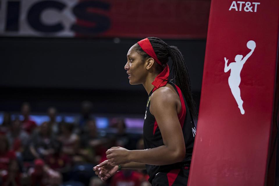 "<p>In her third year in the WNBA, Las Vegas Aces forward A'ja Wilson isn't shying away from discussing racial and social justice. ""I feel like <a href=""https://www.popsugar.com/fitness/ja-wilson-on-2020-wnba-season-social-justice-47631992"" class=""link rapid-noclick-resp"" rel=""nofollow noopener"" target=""_blank"" data-ylk=""slk:it's a part of me"">it's a part of me</a>. It's a part of me to demand change amongst everyone else,"" she told POPSUGAR in July. ""The biggest thing with me is just being a voice for the voiceless. . . . I feel like I'm put on this earth to do that - to speak up for the next generation, to speak up for that young Black girl."" Wilson has <a href=""https://www.theplayerstribune.com/en-us/articles/aja-wilson-dear-black-girls"" class=""link rapid-noclick-resp"" rel=""nofollow noopener"" target=""_blank"" data-ylk=""slk:authored an essay on her experiences with racism"">authored an essay on her experiences with racism</a> and finding her power and used her platform to <a href=""https://www.instagram.com/p/CDsDceRB9fU/"" class=""link rapid-noclick-resp"" rel=""nofollow noopener"" target=""_blank"" data-ylk=""slk:demand justice for Breonna Taylor"">demand justice for Breonna Taylor</a>.</p>"