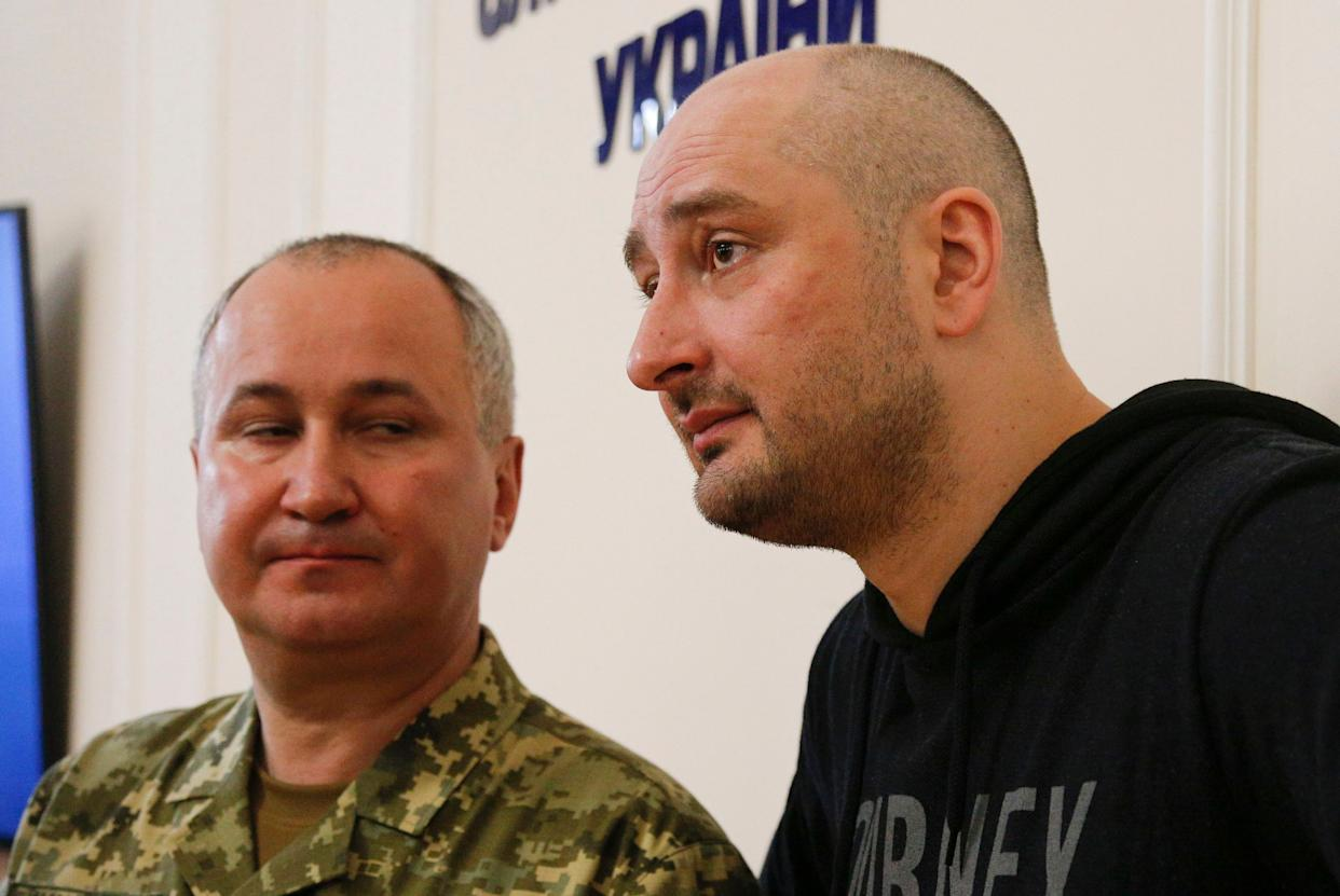 Russian journalist Arkady Babchenko (R) and Vasily Gritsak, head of the Ukrainian Security Service, speaks to the media during a news conference at the Ukrainian Security Service on May 30, 2018 in Moscow