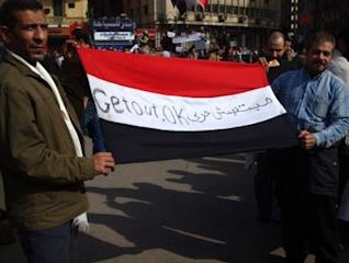 Flag_held_by_two_men_in_Cairo_protest_2011_Egyptian_Revolution