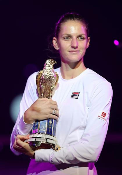 Karolina Pliskova of the Czech Republic poses with the winner's trophy at the WTA Qatar Total Open on February 18, 2017, in Doha