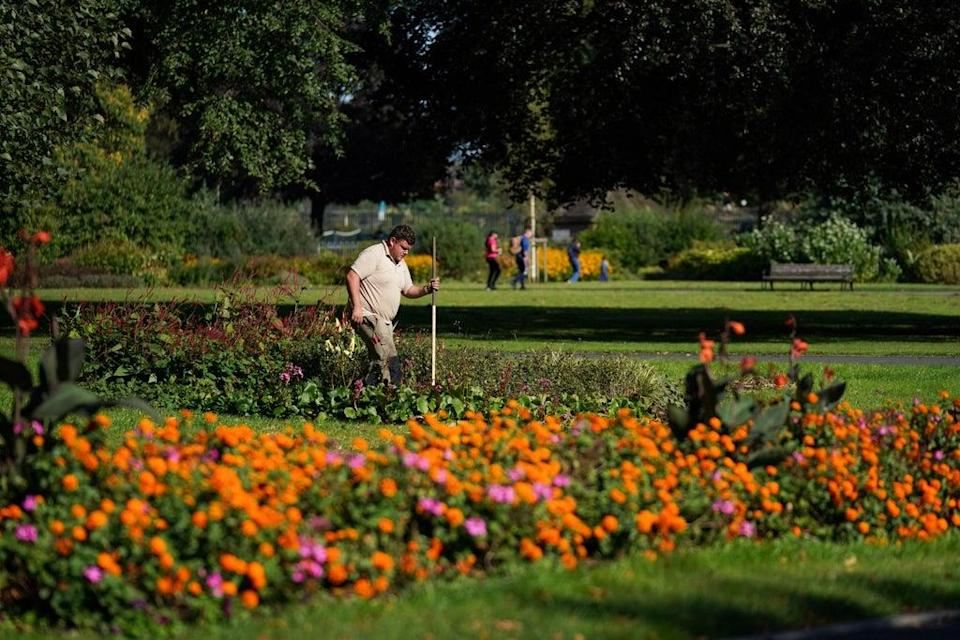 A landscaper maintains the gardens at St Nicholas' Park in Warwick (Jacob King/PA) (PA Wire)