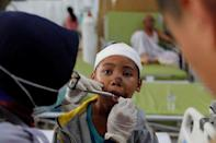 ATTENTION EDITORS - VISUAL COVERAGE OF SCENES OF INJURY OR DEATH Paramedics give treatment to an earthquake survivor at Tanjung hospital after earthquake hit on Sunday in North Lombok, Indonesia, August 7, 2018. REUTERS/Beawiharta