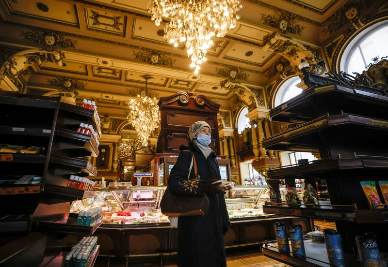 A woman visits Yeliseyevsky Store in central Moscow