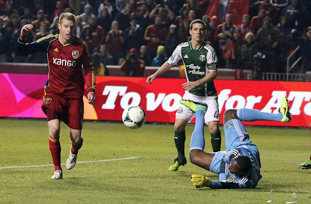 Portland Timbers goalie Donovan Ricketts, right, dives for a save as Real Salt Lake defender Nat Borchers, left, stands by in the first half during the first leg of the MLS Western Conference final Sunday, Nov. 10, 2013, in Sandy, Utah. (AP Photo/Rick Bowmer)