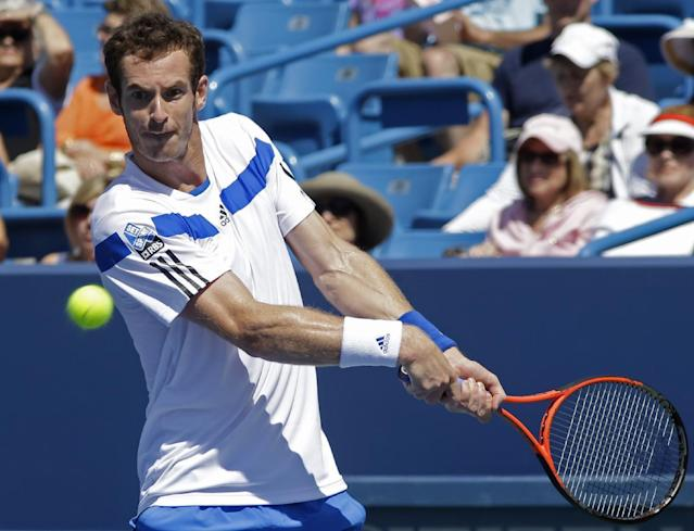Andy Murray, from Great Britain, hits a backhand against Mikhail Youzhny, from Russia, during a match at the Western & Southern Open tennis tournament, Wednesday, Aug. 14, 2013, in Mason, Ohio. Murray won 6-2, 6-3. (AP Photo/Al Behrman)