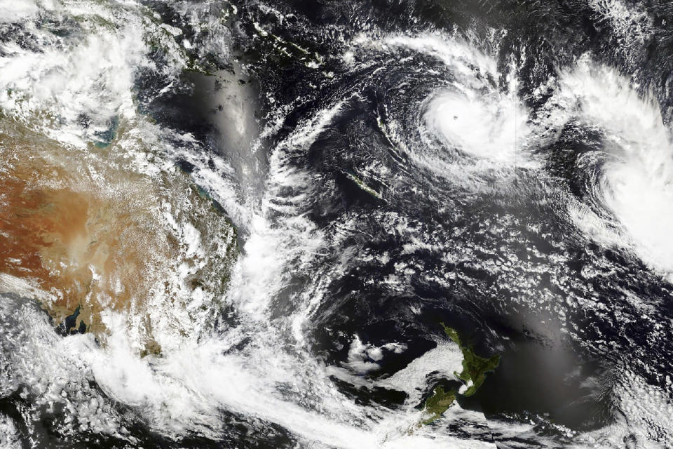 This Tuesday, Dec. 15 2020, satellite image released by NASA Worldview, Earth Observing System Data and Information System (EOSDIS) shows Cyclone Yasa, top center right, over Fiji. Fiji imposed a nationwide curfew Thursday, Dec. 17, 2020 after urging people near the coast to move to higher ground as the island nation prepared for a major cyclone to hit. (NASA via AP)