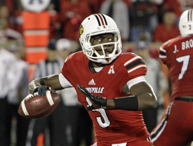 Louisville quarterback Teddy Bridgewater (5) prepares to pass against Central Florida in their NCAA college football game in Louisville, Ky., Friday, Oct. 18, 2013. No. 8 Louisville was upset by unranked Central Florida 38-35, despite Bridgewater's 341 yards passing including two touchdowns. (AP Photo/Garry Jones)