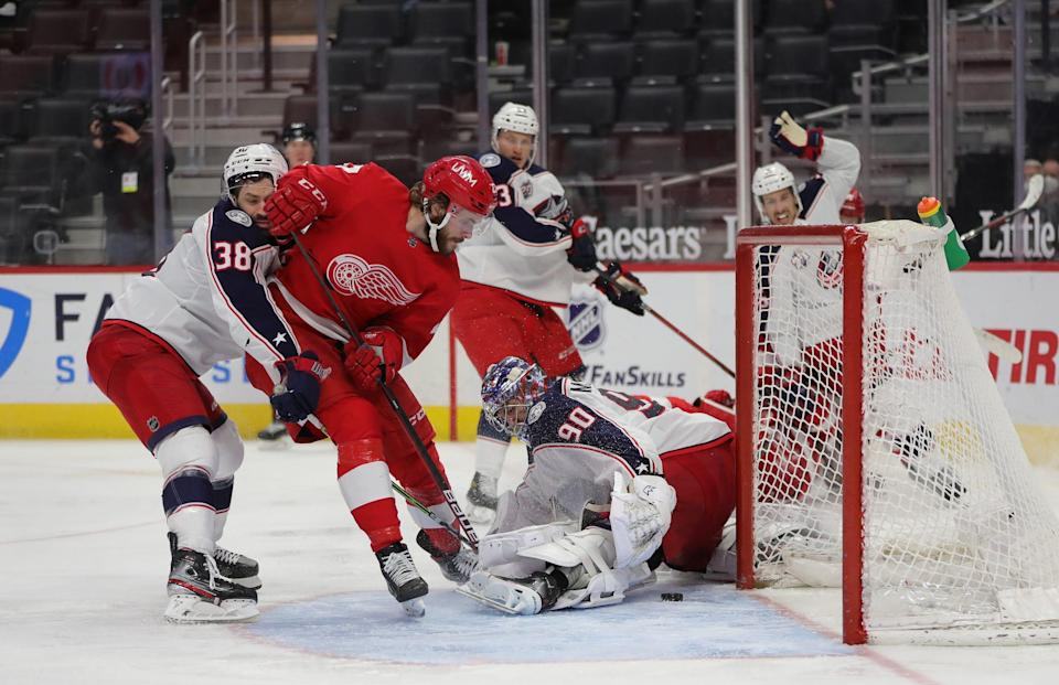 Detroit Red Wings center Michael Rasmussen (27) scores the game winner against Columbus Blue Jackets goaltender Elvis Merzlikins (90) during third period action Sunday, March 28, 2021 at Little Caesars Arena in Detroit.