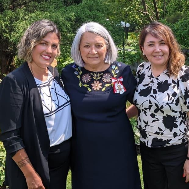 Julie Grenier, left, Mary Simon, centre, and Victoria Okpik, right. Grenier did the beadwork on Simon's dress, while Okpik was the garment's designer. (Submitted by Julie Grenier - image credit)