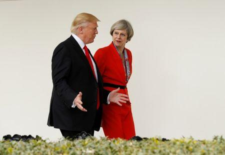 FILE PHOTO: U.S. President Donald Trump escorts British Prime Minister Theresa May down the White House colonnade after their meeting at the White House in Washington, U.S., January 27, 2017.   REUTERS/Kevin Lamarque