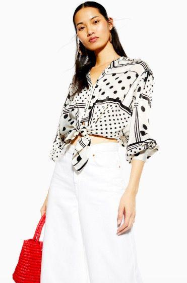 """<p><a class=""""body-btn-link"""" href=""""https://www.topshop.com/en/tsuk/product/new-in-this-week-2169932/new-in-fashion-6367514/mixed-spot-tie-front-shirt-8648415"""" target=""""_blank"""">SHOP NOW</a> £28.00 with student discount</p>"""