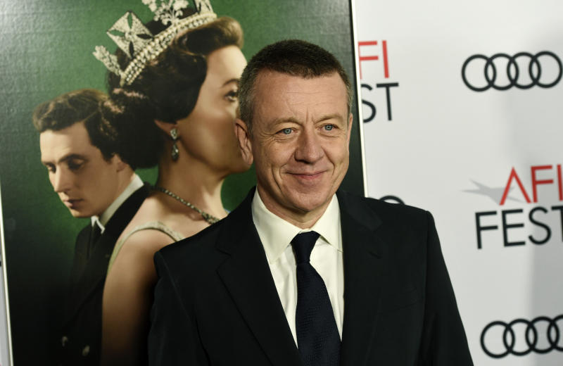 "Peter Morgan, the creator/writer/executive producer of the Netflix series ""The Crown,"" poses at a gala screening of the show at the 2019 AFI Fest at the TCL Chinese Theatre, Saturday, Nov. 16, 2019, in Los Angeles. (Photo by Chris Pizzello/Invision/AP)"