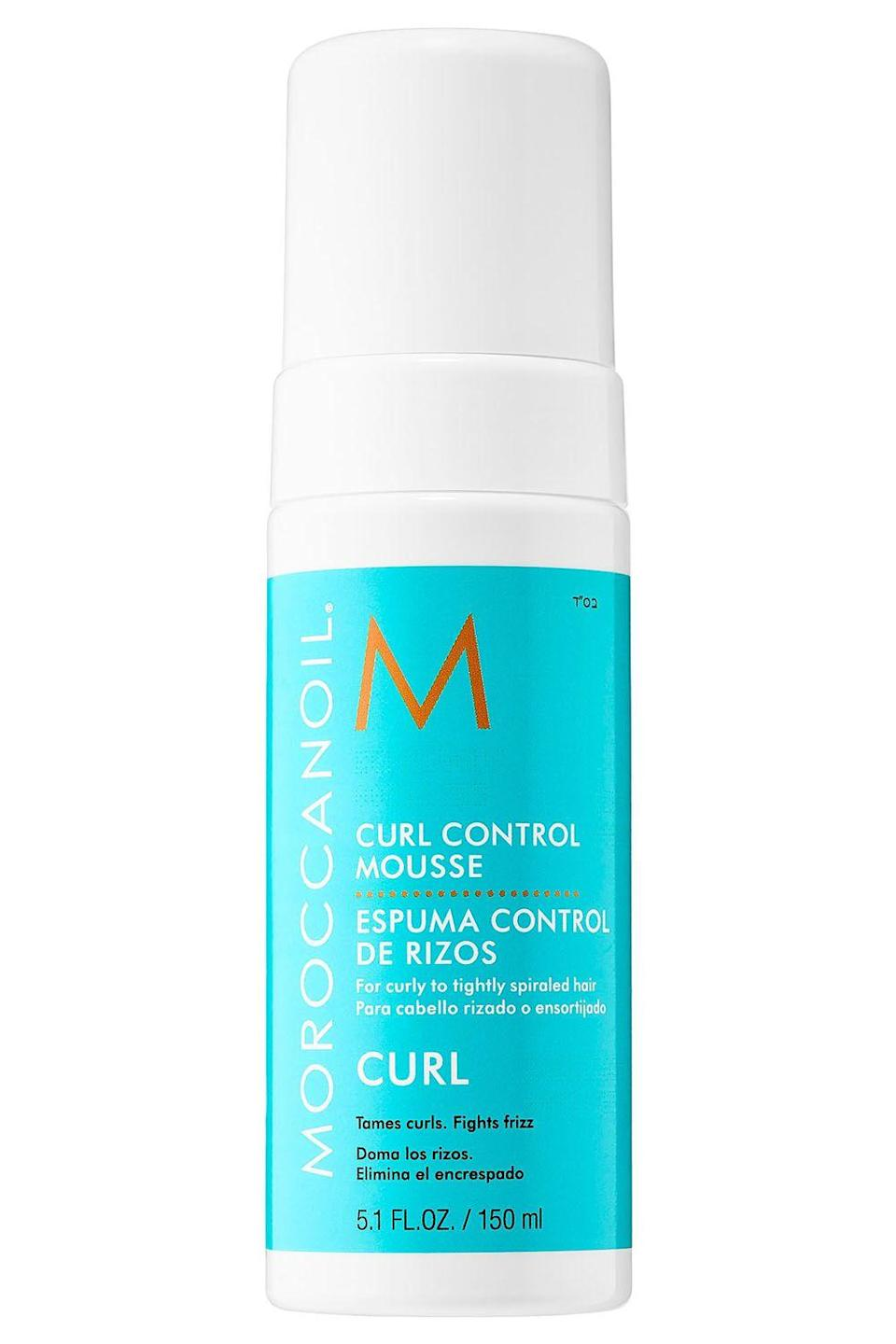 """<p><strong>Moroccanoil</strong></p><p>sephora.com</p><p><strong>$23.00</strong></p><p><a href=""""https://www.sephora.com/product/curl-control-mousse-P427314"""" rel=""""nofollow noopener"""" target=""""_blank"""" data-ylk=""""slk:Shop Now"""" class=""""link rapid-noclick-resp"""">Shop Now</a></p><p>Argan oil is the hero ingredient in this moisturizing mousse. Comb two pumps of the formula to towel-dried hair-not only will it <strong>bring shine and hydration back to your fuzzy <a href=""""https://www.cosmopolitan.com/style-beauty/beauty/a26090163/best-products-4c-curls-hair/"""" rel=""""nofollow noopener"""" target=""""_blank"""" data-ylk=""""slk:curls"""" class=""""link rapid-noclick-resp"""">curls</a> </strong>(thanks, argan oil), but it'll also keep them soft and defined all day long. </p>"""