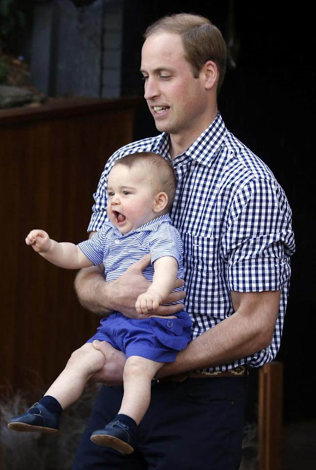 Britain's Prince William holds his son Prince George during a visit to Sydney's Taronga Zoo, Australia Sunday, April 20, 2014. (AP Photo/David Gray, Pool)