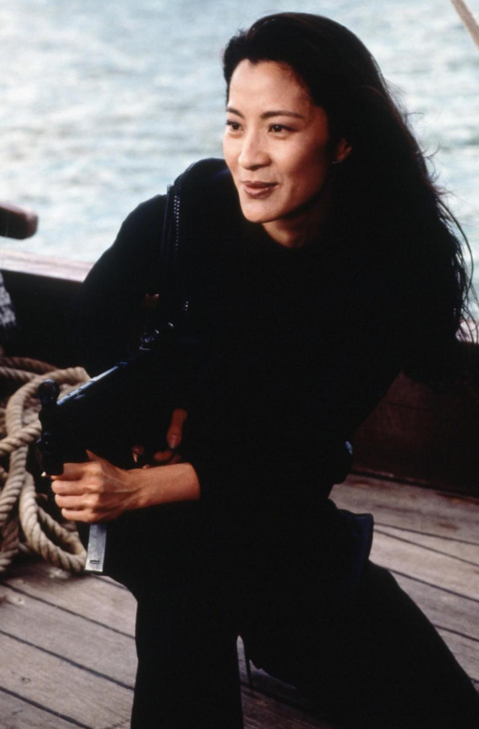 <p>Lin is a tough and beautiful Chinese spy — the only true action hero of the bunch — who works as Bond's accomplice in taking down Carver. From machine guns to martial arts, Lin can take on any adversary. <i>(Photo: Everett Collection)<br></i></p>