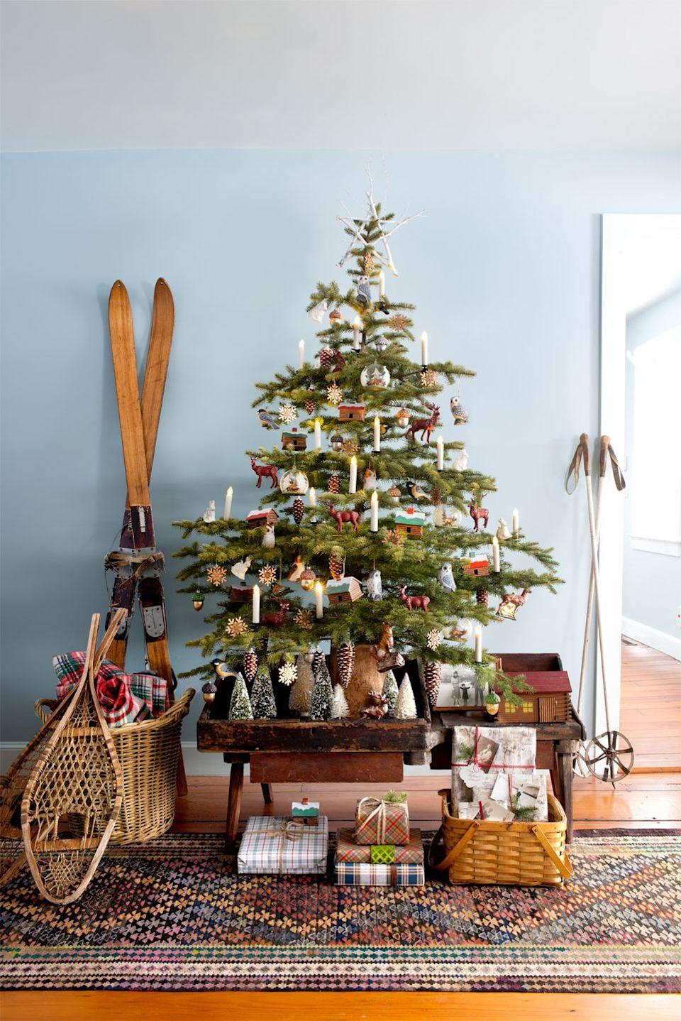 "<p>A cozy Christmas in the country requires (battery-operated) candles plus wooden ornaments. Round out the scene with a pair of old-fashioned snowshoes and bottle-brush trees in place of a skirt. </p><p>See more at <a href=""http://www.countryliving.com/home-design/decorating-ideas/tips/g1251/trim-christmas-trees-1208"" rel=""nofollow noopener"" target=""_blank"" data-ylk=""slk:Country Living"" class=""link rapid-noclick-resp"">Country Living</a>. </p><p><a class=""link rapid-noclick-resp"" href=""https://www.amazon.com/GiveU-Control-Christmas-Candles-Included/dp/B075F4RYK7/ref=sr_1_2?dchild=1&keywords=fake+christmas+tree+candles&qid=1597239824&s=home-garden&sr=1-2&tag=syn-yahoo-20&ascsubtag=%5Bartid%7C10057.g.505%5Bsrc%7Cyahoo-us"" rel=""nofollow noopener"" target=""_blank"" data-ylk=""slk:SHOP LIGHTS"">SHOP LIGHTS</a> <strong><em>Candle Clips, $19</em></strong></p>"
