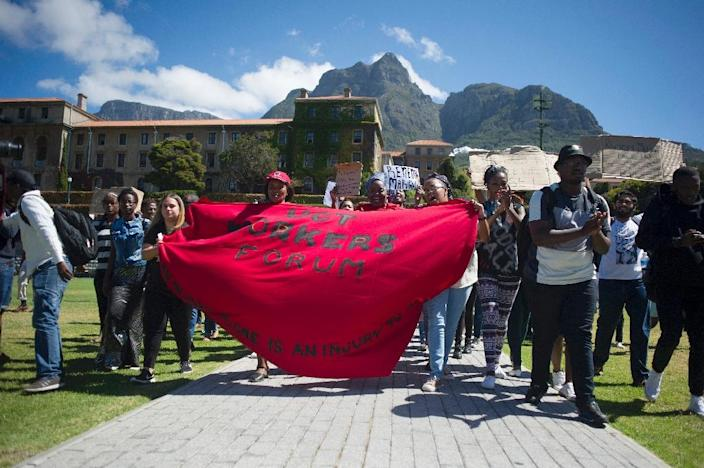 Students and staff of the University of Cape Town (UCT) march on campus during a protest against the statue of British coloniser Cecil John Rhodes at the university in Cape Town on March 20, 2015 (AFP Photo/Rodger Bosch)