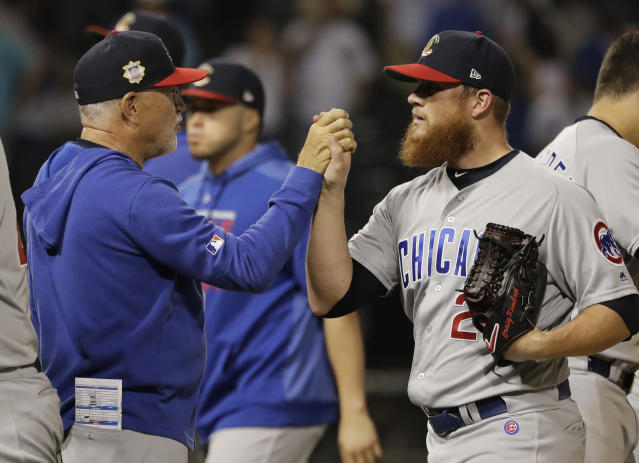 Chicago Cubs closer Craig Kimbrel, right, celebrates with manager Joe Maddon after they defeated the Chicago White Sox in a baseball game in Chicago, Saturday, July 6, 2019. (AP Photo/Nam Y. Huh)