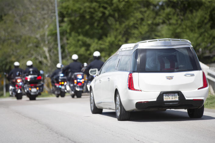 Houston Police escort the body of New Orleans Police detective Everett Briscoe from the Respect for Life Funeral Home for the journey back to New Orleans on Tuesday, Aug. 24, 2021, in Houston. Briscoe was shot and killed Saturday, Aug. 21, at Grotto Ristorante during an attempted robbery while visiting Houston with his fraternity. (Brett Coomer/Houston Chronicle via AP)