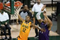 Baylor guard Jared Butler (12) goes up for a shot as Stephen F. Austin's Gavin Kensmil, right, defends in the second half of an NCAA college basketball game in Waco, Texas, Wednesday, Dec. 9, 2020. (AP Photo/Tony Gutierrez)