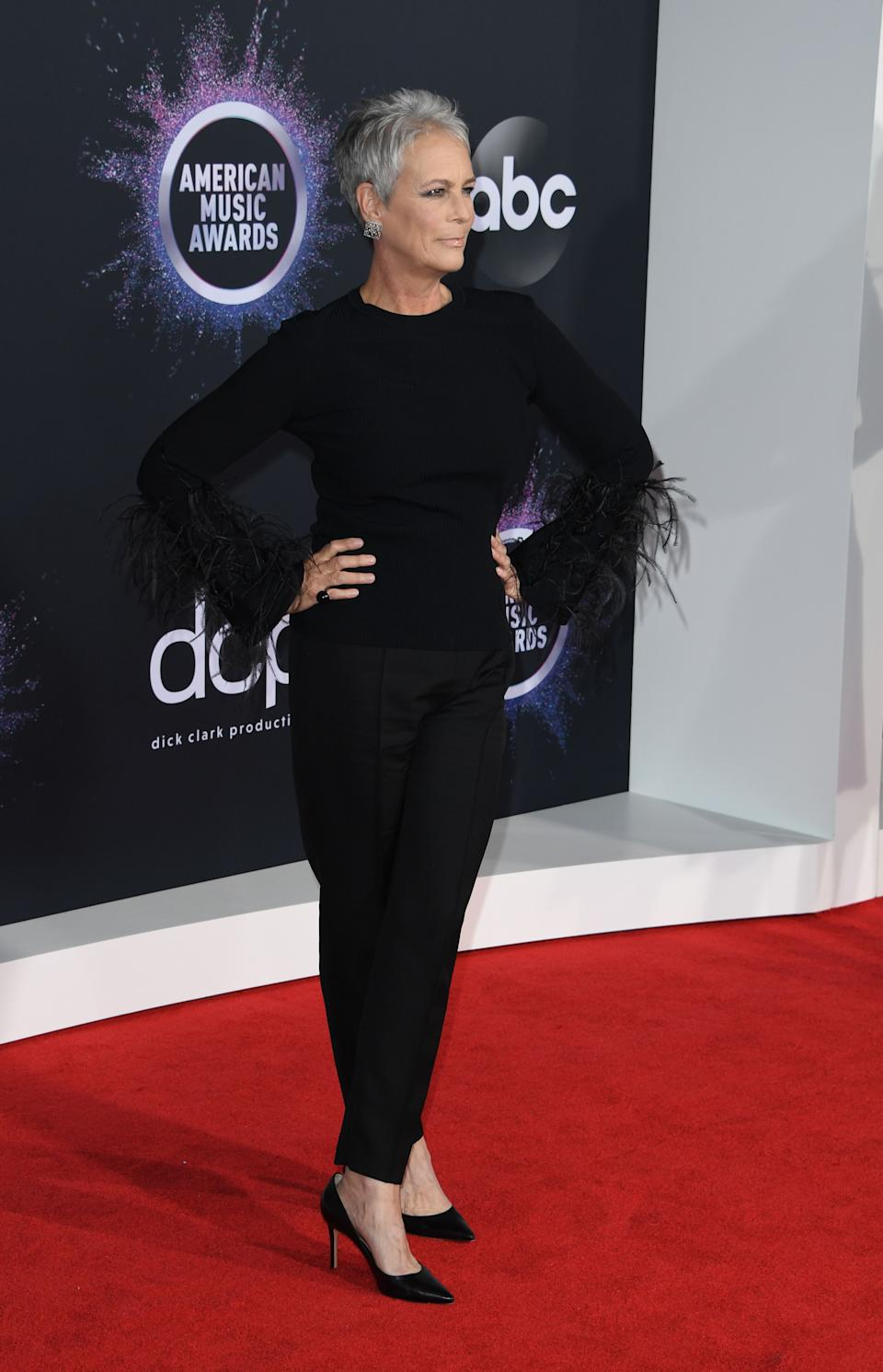 Jamie Lee Curtis wearing a feather sleeved top. <em>[Photo: Getty]</em>
