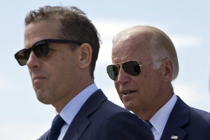 Family members gather for a road naming ceremony with U.S. Vice President Joe Biden, centre, his son Hunter Biden, left, and his sister Valerie Biden Owens, right, joined by other family members during a ceremony to name a national road after his late son Joseph R.