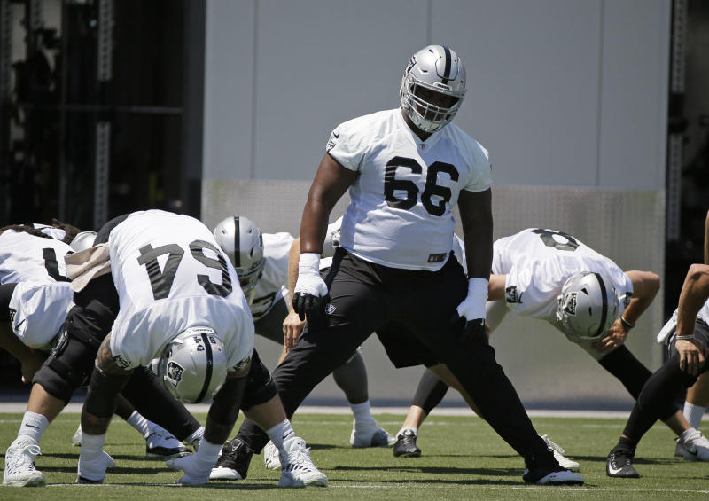 FILE - In this June 11, 2019, file photo, Oakland Raiders offensive guard Gabe Jackson (66) and teammates stretch during the NFL football team's minicamp in Alameda, Calif. The Raiders are concerned about the status of starting right guard Jackson after he injured his leg in a joint practice with the Los Angeles Rams. Jackson went down early in the session Thursday, Aug. 8, when someone rolled into his leg. Jackson was then taken off the field on a cart and owner Mark Davis went into the locker room shortly after that for almost 15 minutes. (AP Photo/Eric Risberg, File)