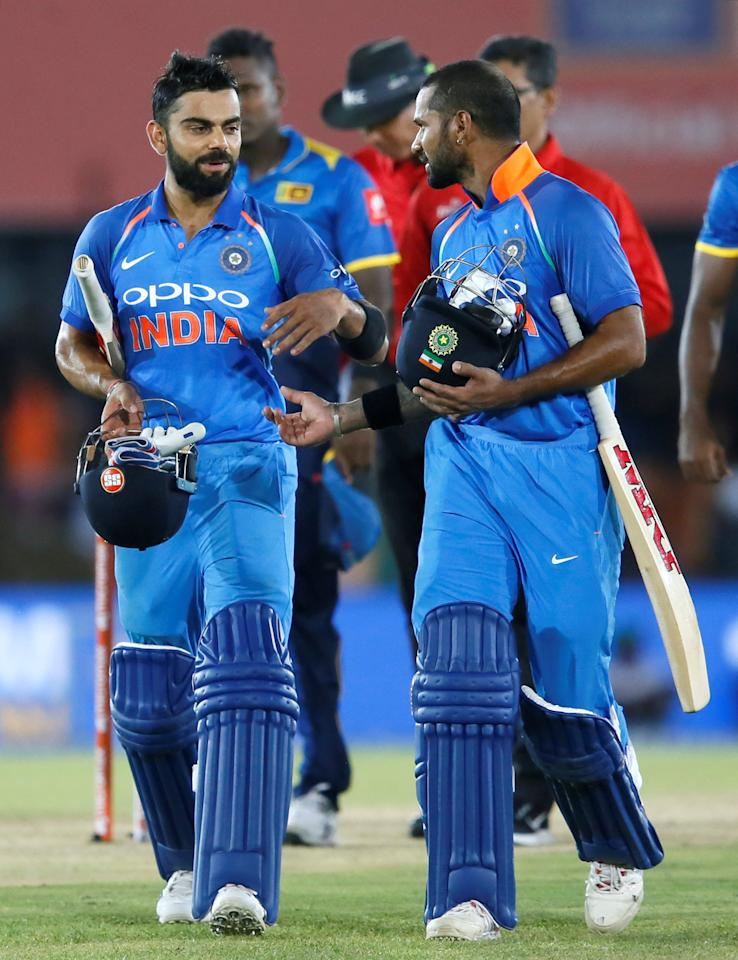 <p>India's captain Virat Kohli and Shikhar Dhawan celebrate after victory. REUTERS/Dinuka Liyanawatte </p>