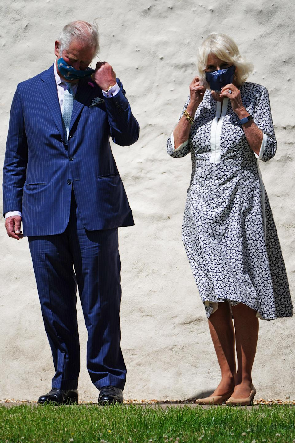 The Prince of Wales and the Duchess of Cornwall wearing masks (PA Wire)