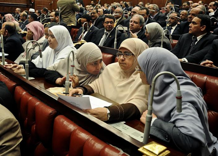 Members of the constitutional assembly speak during a session at the Shura Council building in Cairo, Egypt, Wednesday, Dec. 26, 2012. The official approval of Egypt's disputed, Islamist-backed constitution Tuesday held out little hope of stabilizing the country after two years of turmoil and Islamist President Mohammed Morsi may now face a more immediate crisis with the economy falling deeper into distress. (AP Photo/Mohammed Asad)