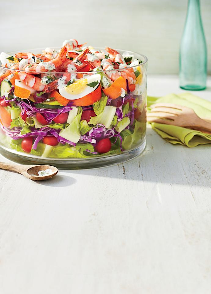 "<p>Layered salads are great for entertaining-and this one is no different. It uses shrimp in place of the classic bacon for a cobb salad that's a little brighter, fresher, and perfect for the beach or any summer gathering. If you don't have buttermilk, you can make your own by thinning yogurt with a little bit of milk (or water in a pinch). You can assemble the salad up to eight hours in advance, making sure to keep the dressing separate until you're ready to serve. </p><strong><a rel=""nofollow"" href=""http://www.myrecipes.com/recipe/coastal-cobb-salad"">Recipe: Coastal Cobb Salad</a></strong>"