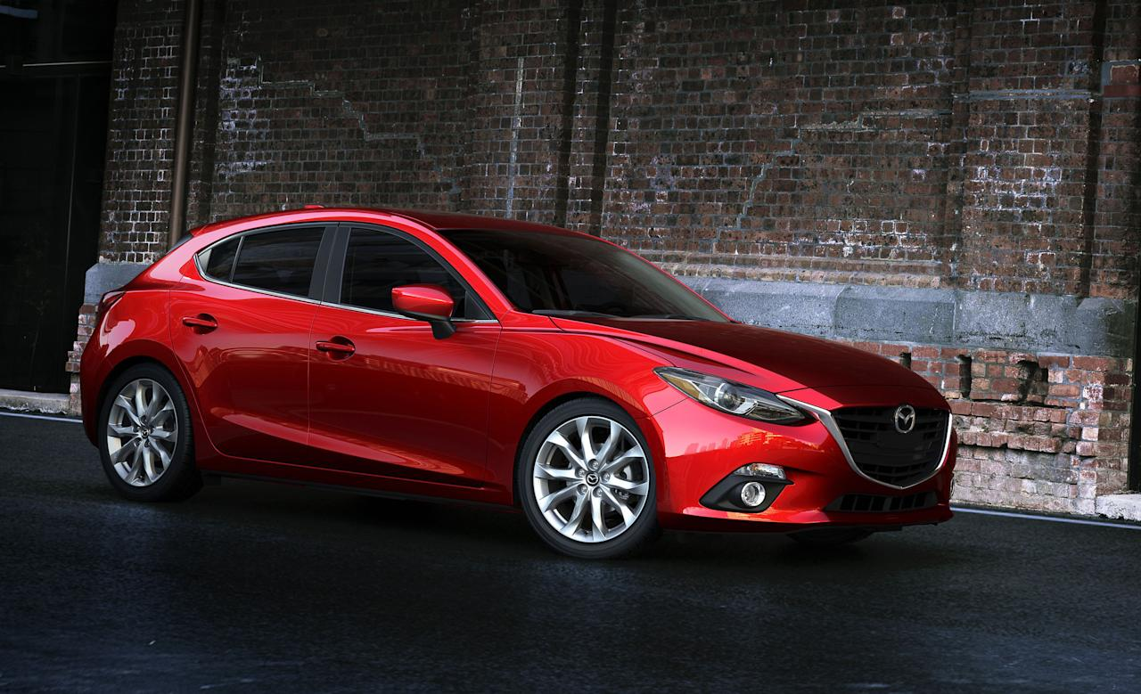This publicity photo provided by Mazda North American Operations shows the 2014 Mazda3. The third generation Mazda3 small car, which goes on sale this fall, now has the same elegant swooping lines, elongated hood and narrow headlights of the larger Mazda6. The Mazda3 now has Mazda's Skyactiv suite of fuel-saving technologies, including which includes lighter materials and a more efficient engine. (AP Photo/Mazda North American Operations)