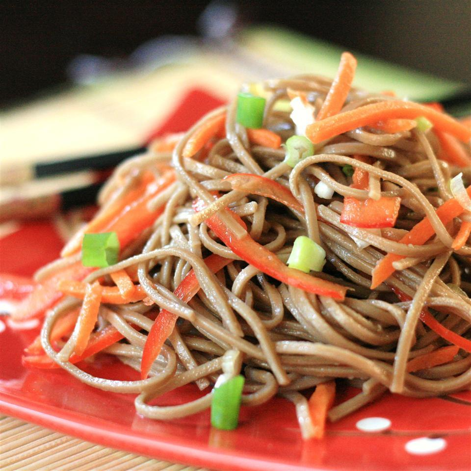 """<p>""""In a word: yum! This is an excellent recipe,"""" says R_ANNE. """"I love soba noodles, and here their wonderful flavor and texture are enhanced by the delicious marinade. Carrots and red bell peppers add crunch, and the green onions are the perfect finishing touch. Not only is this delicious, but it's also quite healthy, too.""""</p>"""