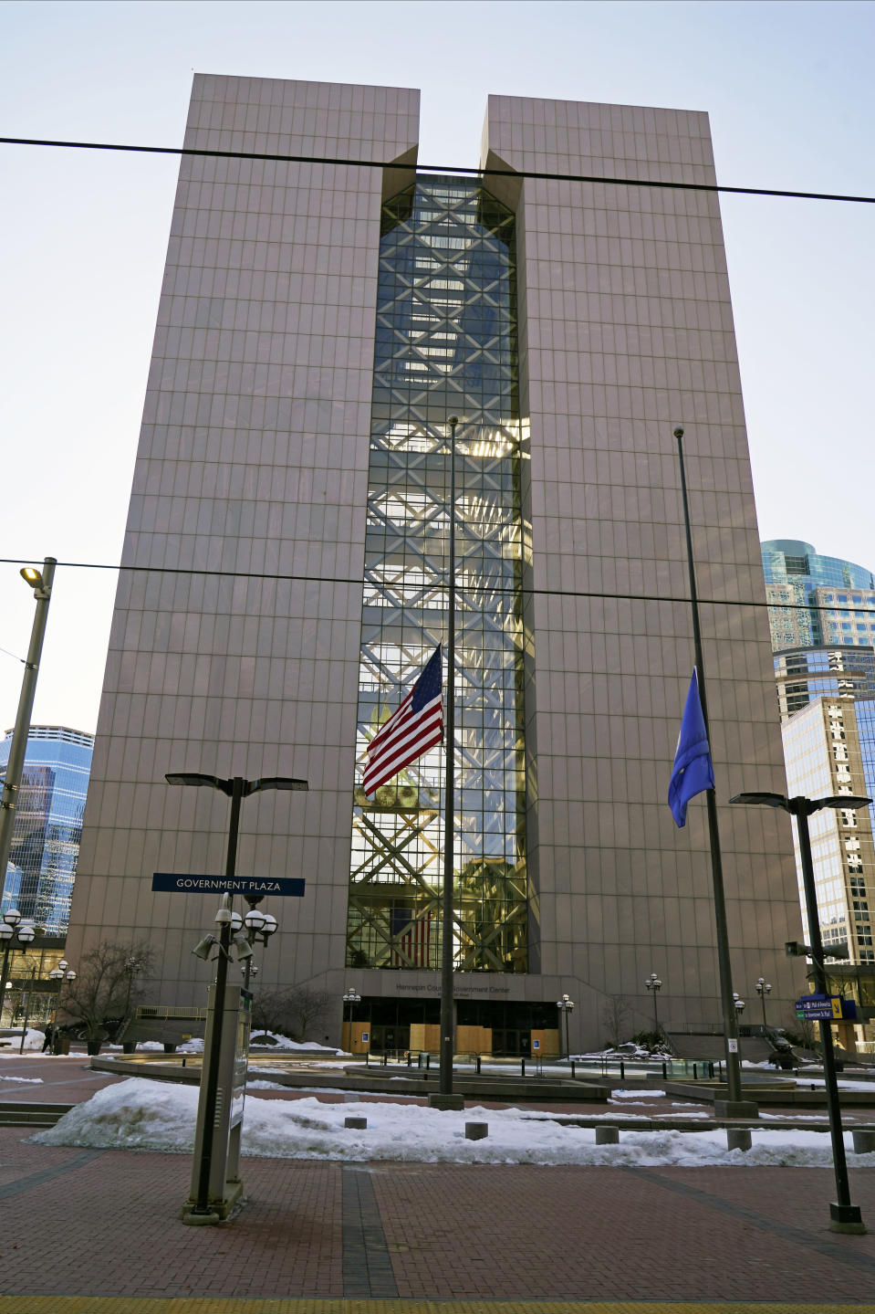 The Hennepin County Government Center is shown, Wednesday, Feb. 23, 2021, in Minneapolis, where the trial of former Minneapolis police officer Derek Chauvin will begin with jury selection March 8. Chauvin is charged with murder in the death of George Floyd during an arrest last May in Minneapolis. (AP Photo/Jim Mone)