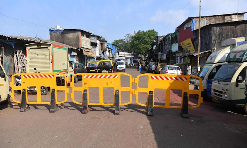 Barriers on a road leading to a quarantined area inside the Dharavi slum
