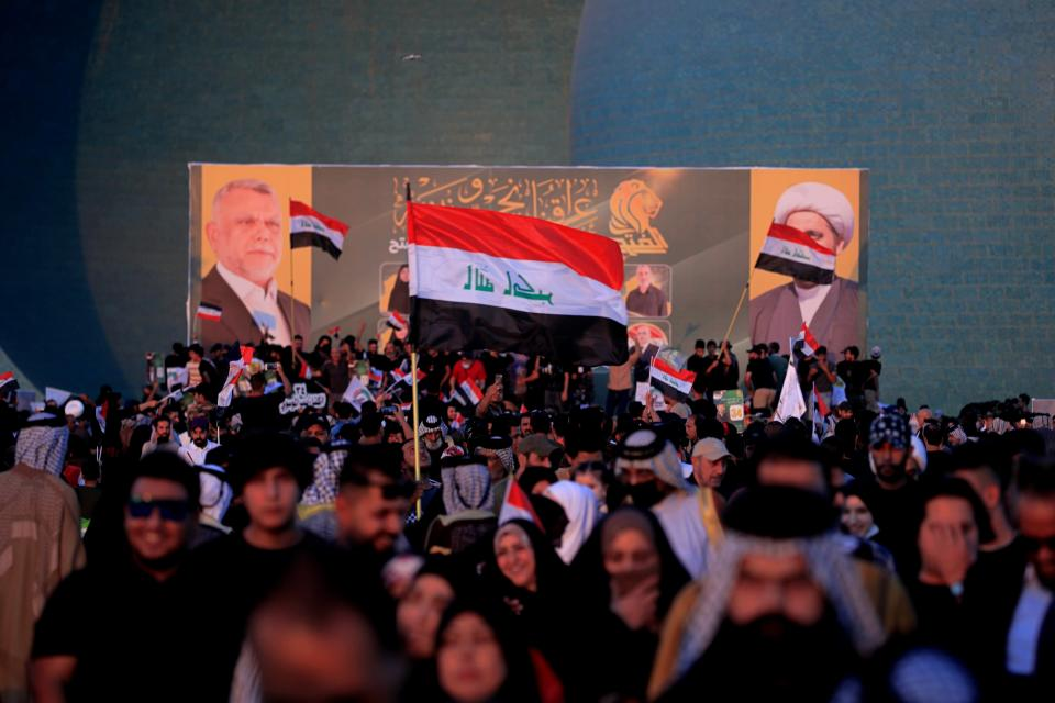 """Followers of a political movement called """"Al-Fateh Alliance"""" chant during a rally before the parliamentary elections in Baghdad, Iraq, Thursday, Oct. 7, 2021. Iraq on Sunday, Oct. 10, holds its fifth election since the 2003 U.S.-led invasion that toppled Iraqi dictator Saddam Hussein, with most Iraqis longing for real change. (AP Photo/Hadi Mizban)"""