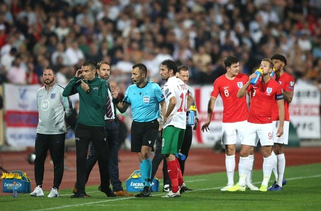 Referee Ivan Bebek (centre) twice stopped England's match in Bulgaria following racist abuse from fans (Nick Potts/PA)