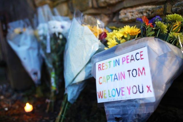 Floral tributes left outside the home of Sir Tom