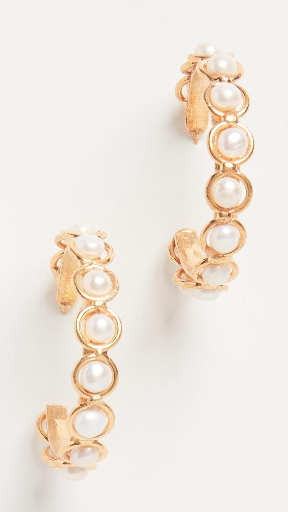 <p>I'm loving hoops, and I'm loving pearls. Combine the two to create these cute <span>Sylvia Toledano Candies Earrings</span> ($155).</p>