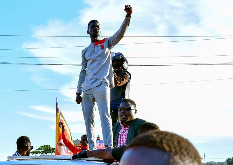 FILE PHOTO: Ugandan pop star and presidential candidate Bobi Wine campaigns near Kampala