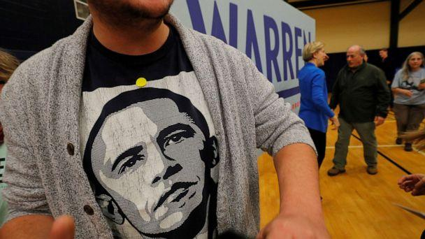 PHOTO: A voter wearing a T-shirt of former President Barack Obama walks away after posing for a photograph with Democratic 2020 presidential candidate and Sen. Elizabeth Warren, D-Mass., at a campaign event in Nashua, N.H., Feb. 5, 2020. (Brian Snyder/Reuters)