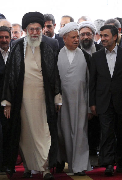 In this photo taken on Thursday, Aug. 30, 2012, and released by an official website of the Iranian supreme leader's office, supreme leader Ayatollah Ali Khamenei, left, chief of Expediency Council, Akbar Hashemi Rafsanjani, center, and President Mahmoud Ahmadinejad, right, arrive at the opening session of the Nonaligned Movement, NAM, summit, in Tehran, Iran. (AP Photo/Office of the Supreme Leader)