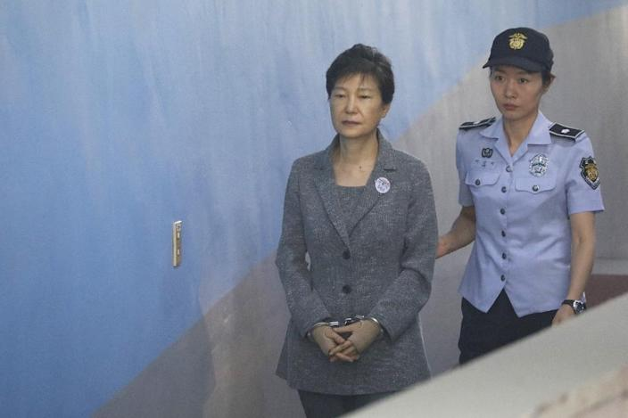 Park Geun-hye is the third former South Korean president to be convicted on criminal charges after leaving office (AFP Photo/KIM HONG-JI)