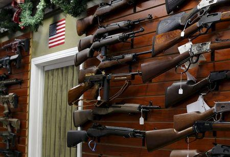 Firearms are shown for sale at the AO Sword gun store in El Cajon