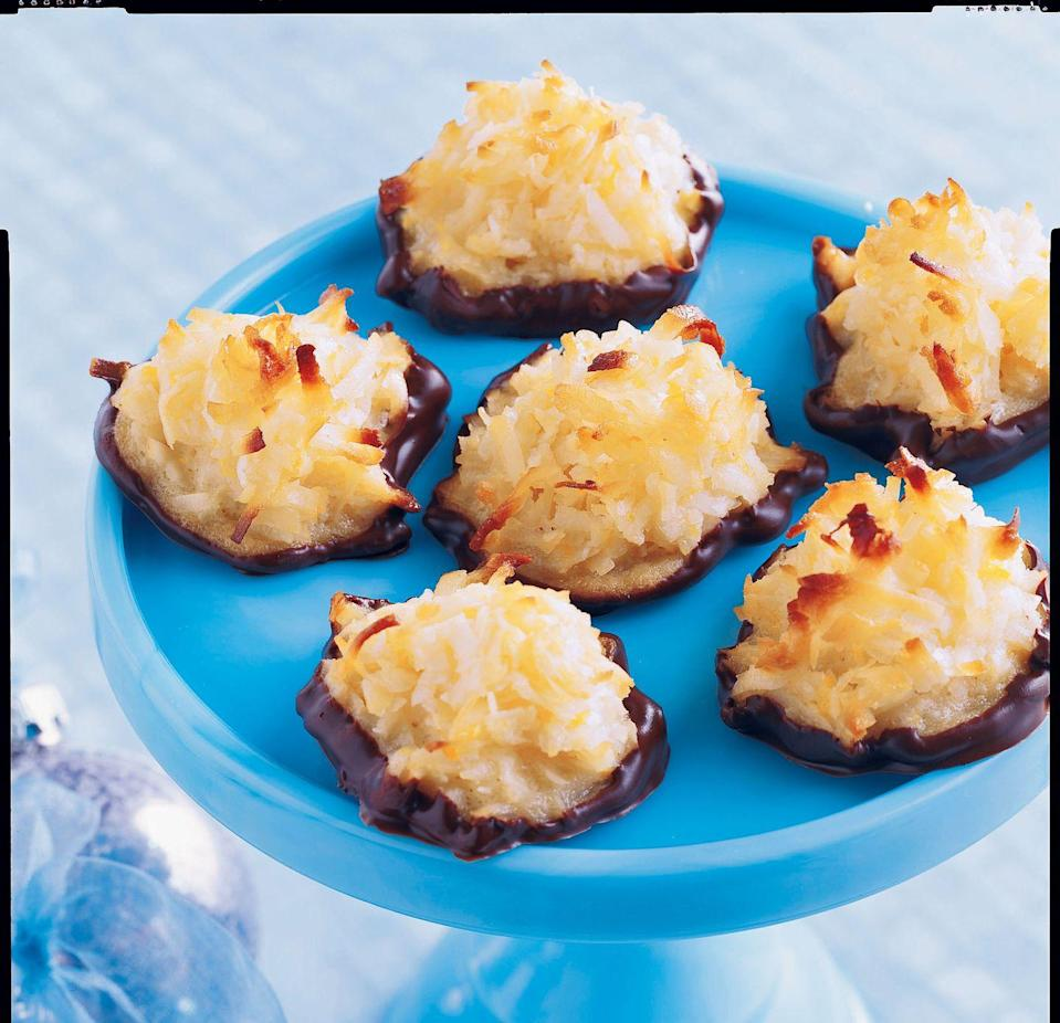 """<p>Add orange peel and vanilla to your coconut macaroons for extra festive flavor.</p><p><em><a href=""""https://www.womansday.com/food-recipes/food-drinks/recipes/a9766/chocolate-dipped-macaroons-121703/"""" rel=""""nofollow noopener"""" target=""""_blank"""" data-ylk=""""slk:Get the recipe from Woman's Day »"""" class=""""link rapid-noclick-resp"""">Get the recipe from Woman's Day »</a></em></p>"""