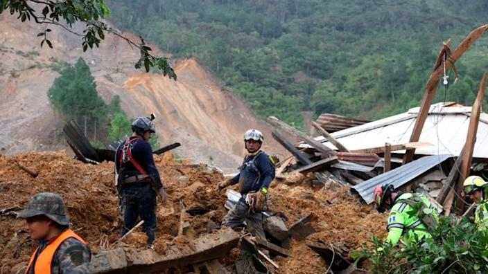 Rescue workers at the scene of a landslide in the village of Quejá, Guatemala. Photo: 7 November 2020