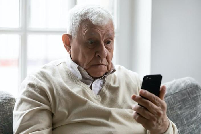 """<span class=""""caption"""">A digital ID won't necessarily make things easier for everyone.</span> <span class=""""attribution""""><a class=""""link rapid-noclick-resp"""" href=""""https://www.shutterstock.com/image-photo/old-man-sit-on-sofa-hold-1679792968"""" rel=""""nofollow noopener"""" target=""""_blank"""" data-ylk=""""slk:Fizkes/Shutterstock"""">Fizkes/Shutterstock</a></span>"""