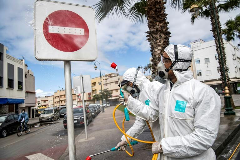 Health ministry workers (pictured March 22, 2020) disinfect the streets of Rabat, the capital of Morocco, where the government has approved the use of hydroxychloroquine to treat the coronavirus
