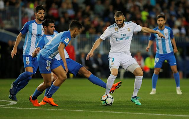 Soccer Football - La Liga Santander - Malaga CF vs Real Madrid - La Rosaleda, Malaga, Spain - April 15, 2018 Real Madrid's Karim Benzema in action with Malaga's Federico Ricca REUTERS/Jon Nazca